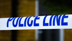 A police tape surrounds a crime scene in London...