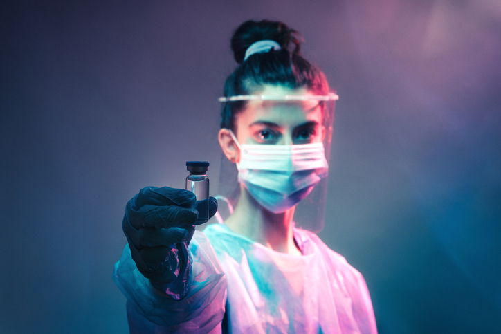 Brave Healthcare Worker Holding Vial of Vaccine