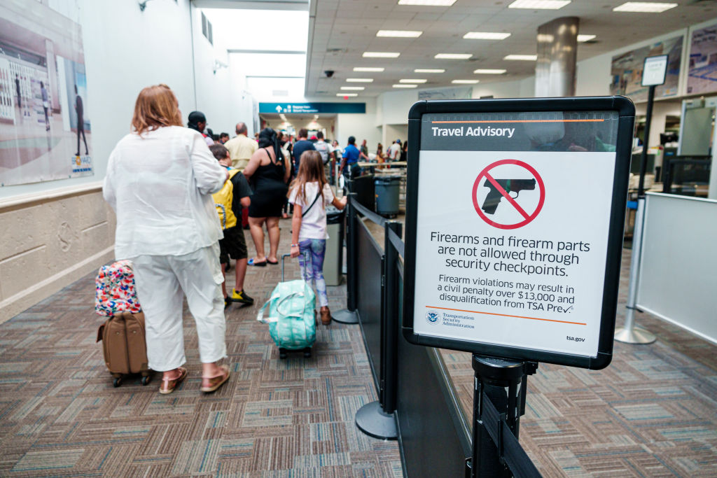 Florida, Fort Lauderdale, Airport TSA security screening checkpoint, information sign about firearms