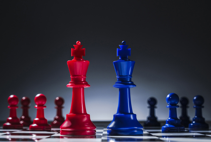 Studio shot of red and blue chess pawns symbolizing US Democratic and Republican parties