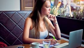 Young woman is learning at a cafe