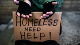 Homeless man begging for money on the street