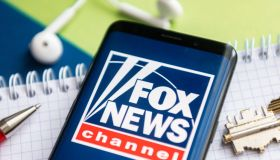 In this photo illustration, a Fox News logo seen displayed...