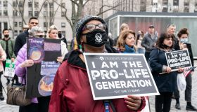 A woman holding a placard takes part during anti-abortion...