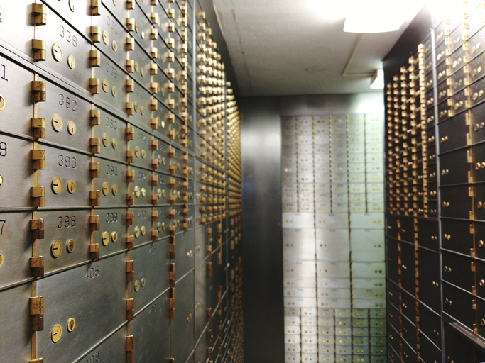 Interior Of Illuminated Safe Deposit Vault.