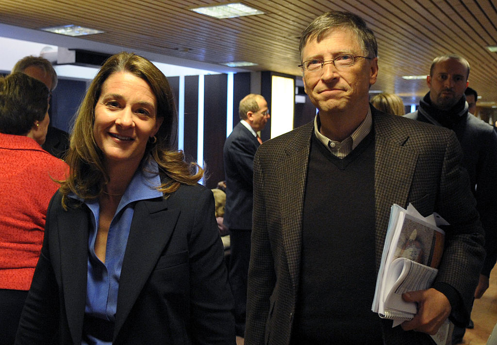 Bill and Melinda Gates walk in the Congr
