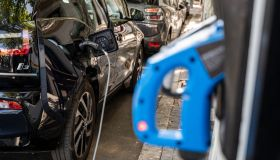 Detail of electric car charging at a charging point in a...