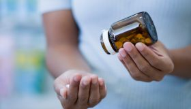 Woman taking pills close-up